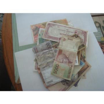 Collection of Thirty Two notes from around the world. See scans